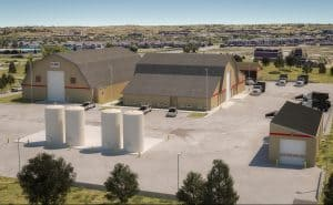 Exterior rendering of the E 470 maintenance support site designed by D2C Architects Inc. There are several large barns and storage spaces.